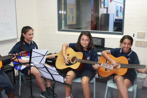 students learning guitar