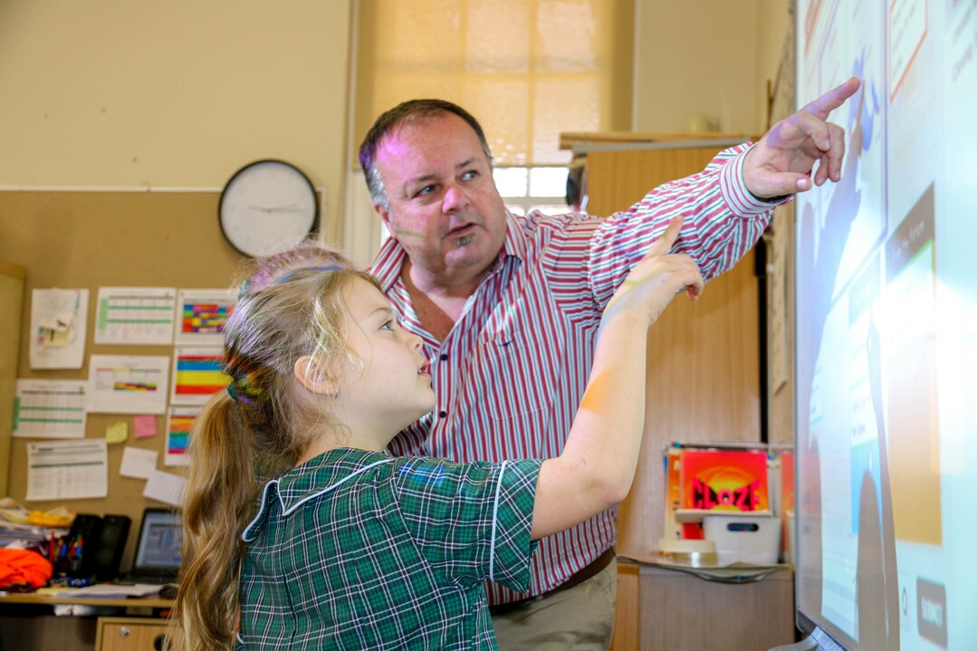 teacher and student using smartboard