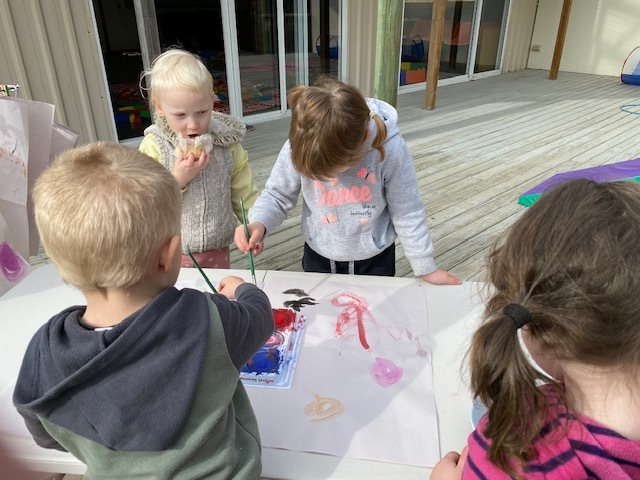 alanah, ajay, molly and piper painting