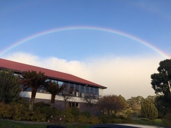 school landscape with rainbow in sky