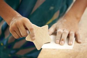 student sanding star