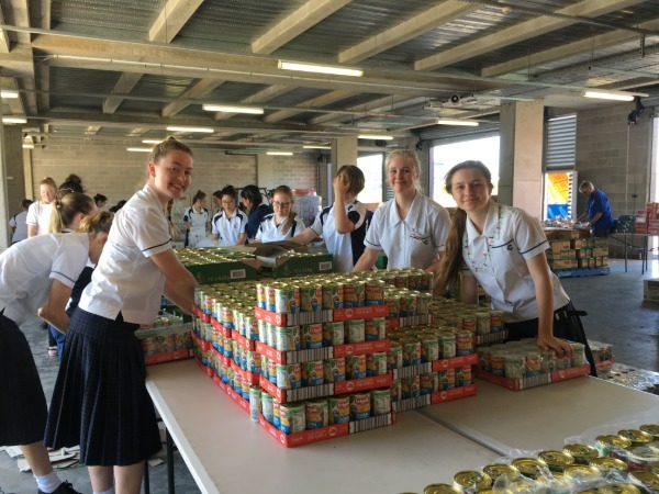 students stacking cans