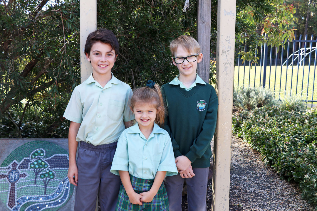 school kids next to bell