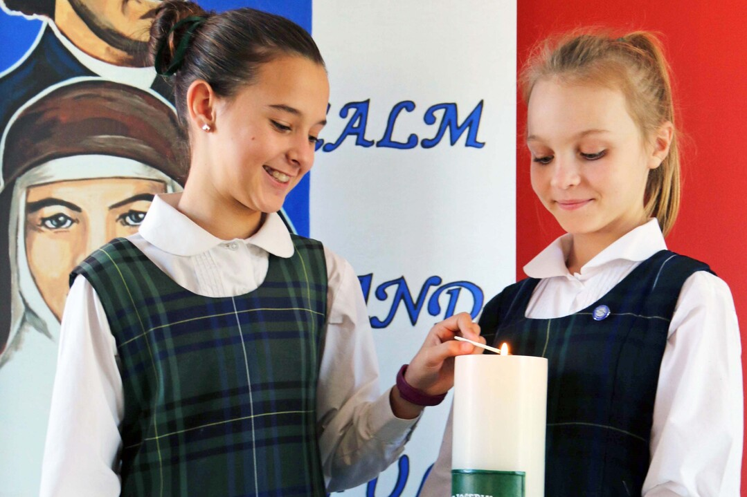 students lighting a candel