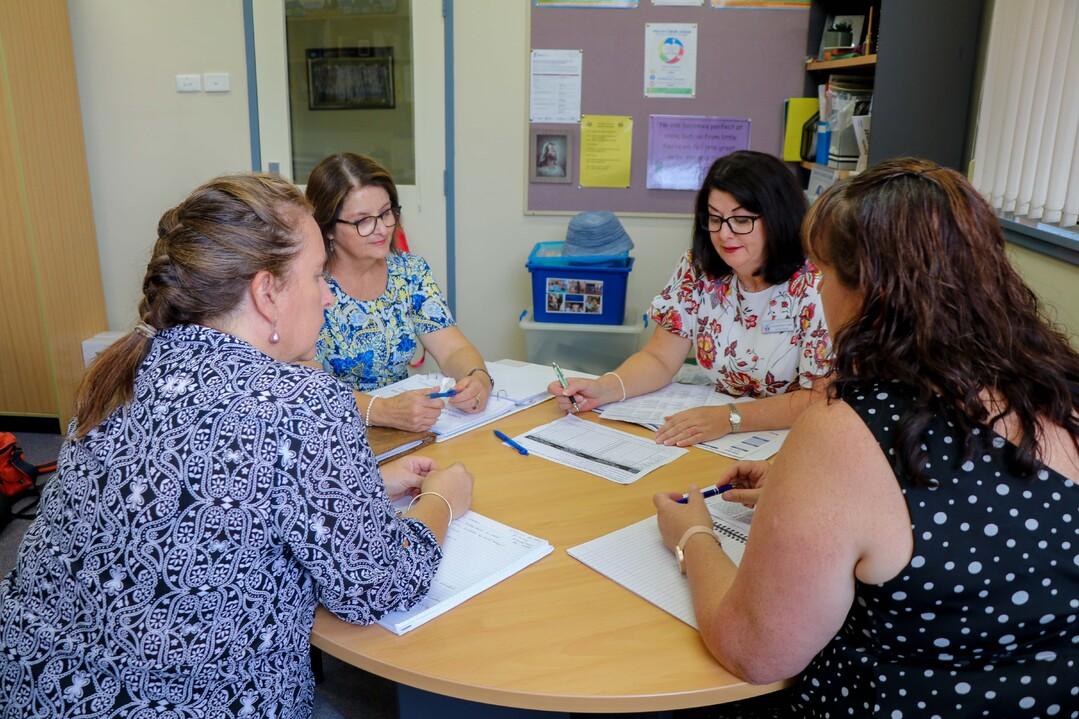 staff around desk planning (2)