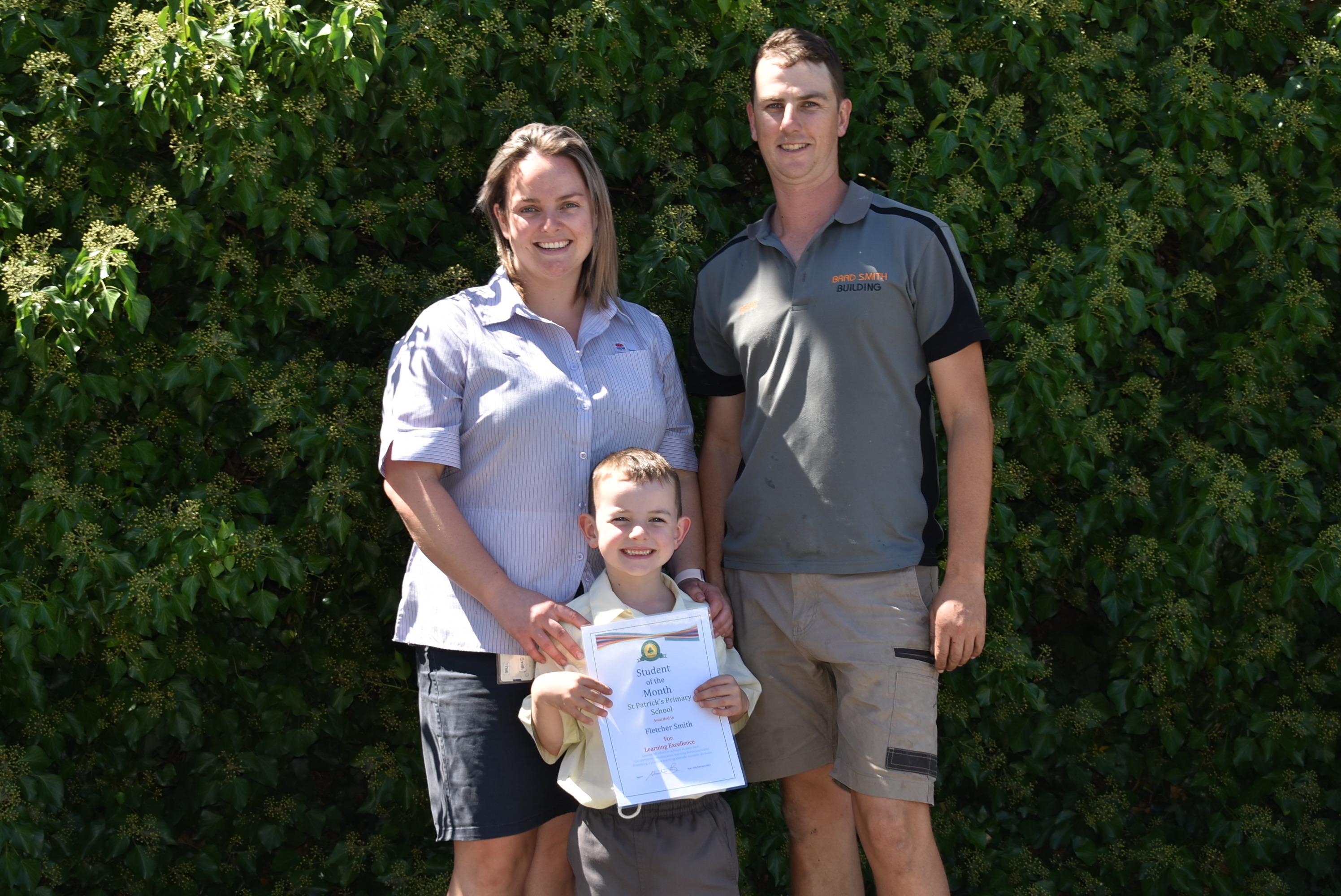 Fletcher with parents Wk 5 T1