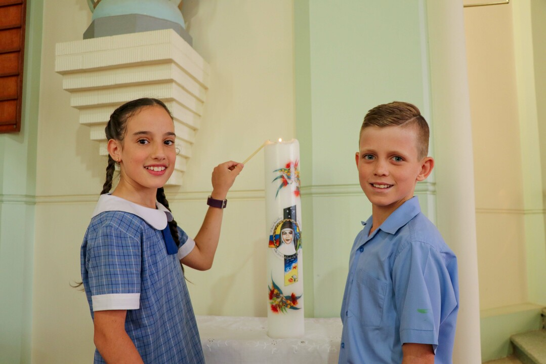 Students lighting church candle