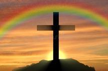 religion_christianity_cross_silhouette_against_sunset_rainbow_76458138.jpg
